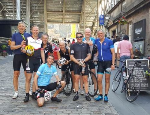 Cycling Businessmen Support Local Kids